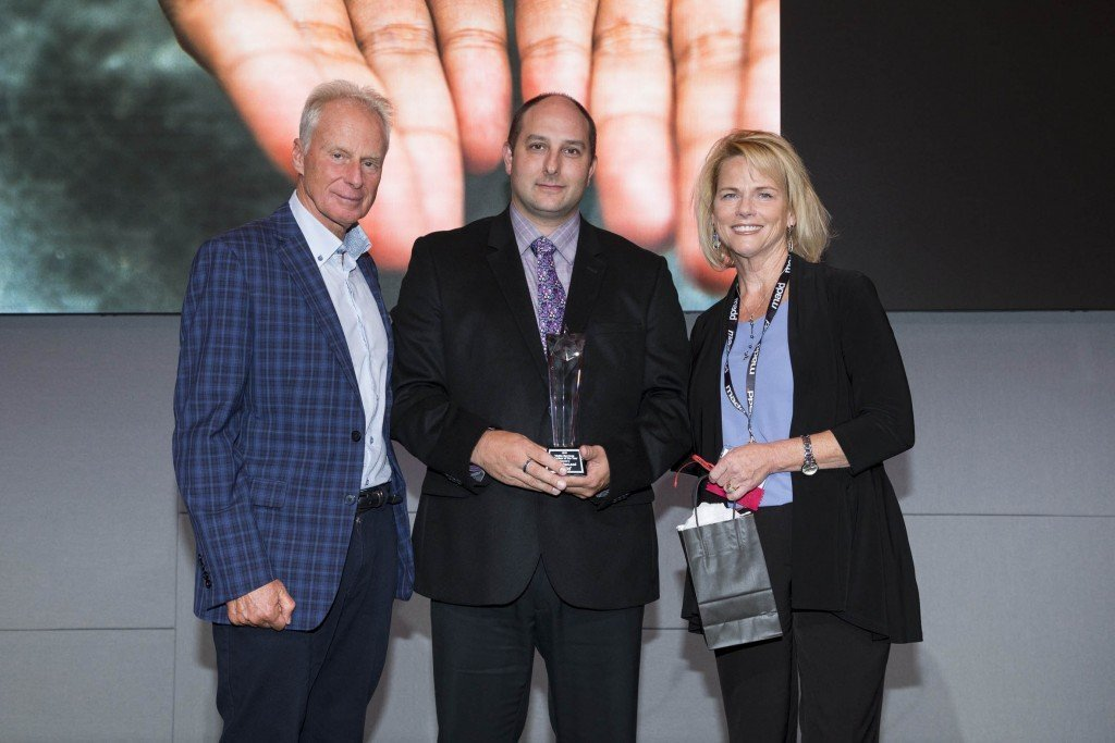 MADD Halifax Regional Chapter President John MacLeod (centre) receives the Victim Services Volunteer of the Year Award from MADD Canada Chief Executive Officer Andrew Murie and National Board of Directors Chairperson Susan Steer